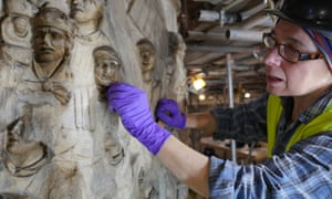 a conservator working on Trajan's Column at the V&A