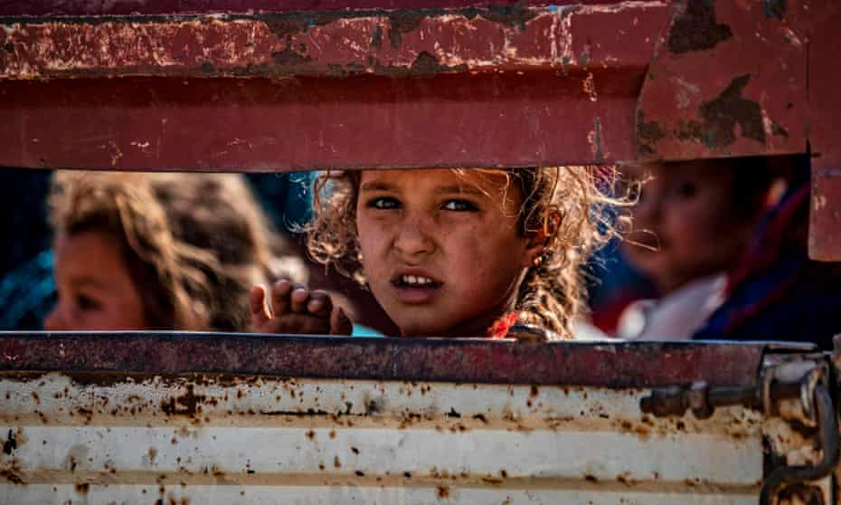 Syrian Arab and Kurdish civilians arrive to Tall Tamr town, in the Syrian northwestern Hasakeh province, after fleeing Turkish bombardment.