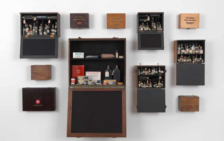 Emergency case: Homage to Joseph Beuys, 1969-2012 (13 wooden felt-lined first aid cabinets, containing bottles of holy water and vintage first aid supplies), by Susan Hiller