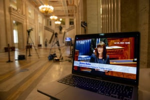 A laptop at Stormont showing Nichola Mallon speaking in the debate.