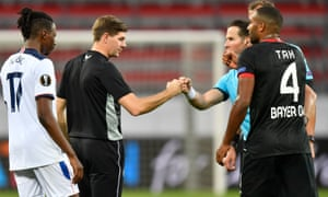 The Rangers head coach Steven Gerrard (left) bumps knuckles with the referee Danny Makkelie after their Europa League loss at the BayArena.