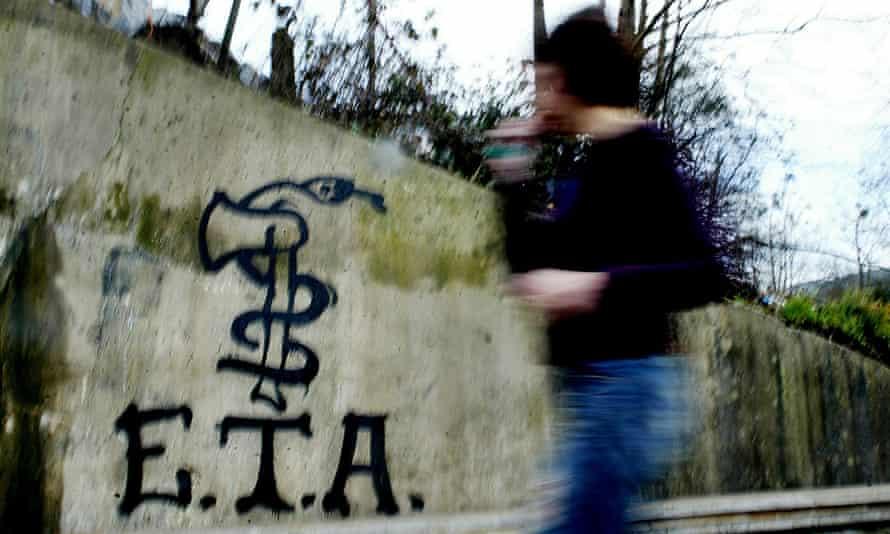 Graffiti depicting the logo of Eta near Bilbao in 2006.