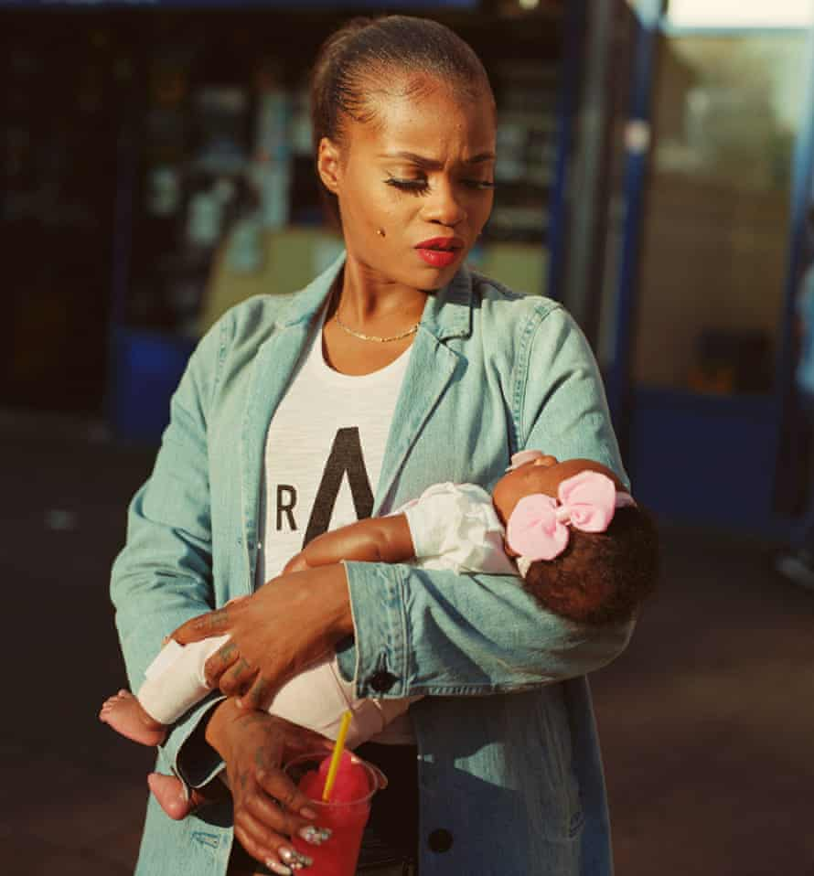 Cybil McAddy holds her daughter Lulu in Clapton, east London