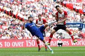 Southampton's Maya Yoshidaclashes with Chelsea's Olivier Giroud as he attempts an overhead kick. Giroud went on to score helping Chelsea win 2-0 and book a place in the final.