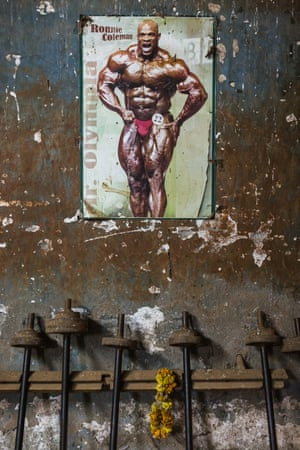 A poster of the famous US bodybuilder Ronnie Coleman – eight times Mr Olympia champion – stands on the wall of the gym as an inspiration for the athletes