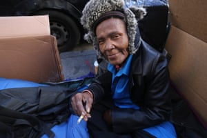Coy Catley, 63, in her homeless box made of cardboard sheets on a sidewalk of Tenderloin, San Francisco.