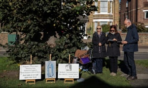 Anti-abortion protesters hold a vigil outside the Marie Stopes clinic in Ealing