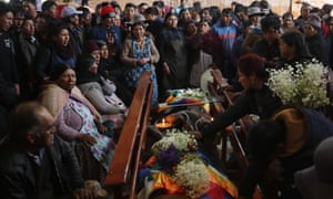 Mourners with the bodies of those killed in clashes between Evo Morales supporters and security forces in El Alto this week.
