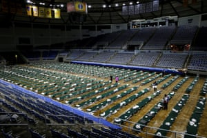 Cots are set up in the Burton Coliseum.