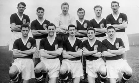 The Scotland football team set to take part in the 1958 World Cup in Sweden, with John Hewie on the far left in the back row.