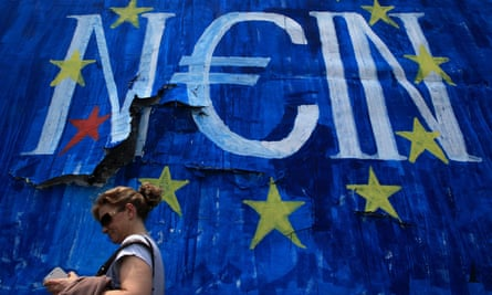 A woman passes by a graffiti in Athens reading 'No' in German.