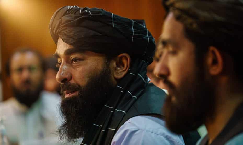 Zabihullah Mujahid, the Taliban spokesman, holds a press conference.