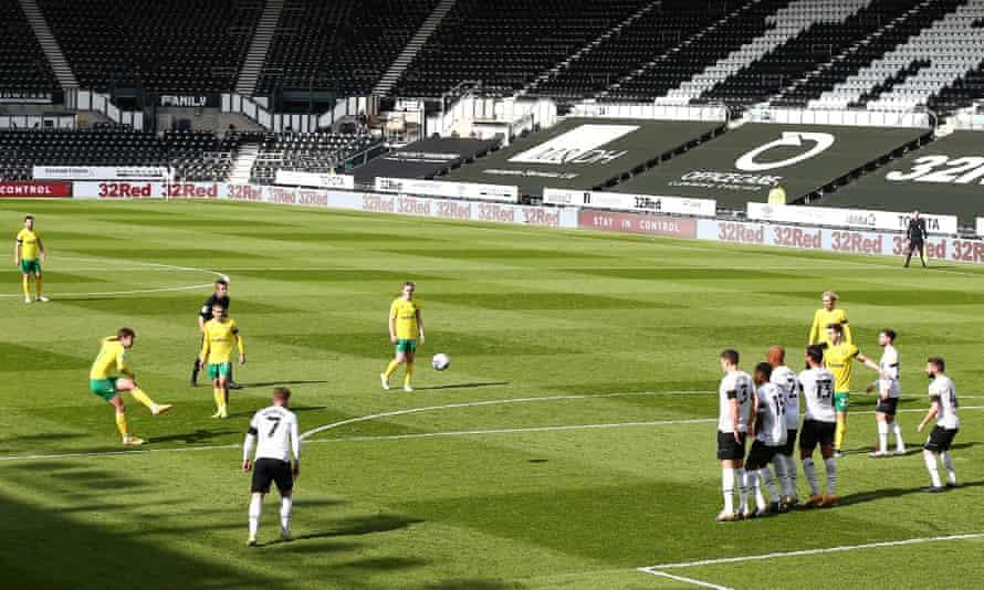 Kieran Dowell sends his decisive free-kick towards the top corner for Norwich.