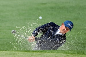 Phil Mickelson plays a shot from a bunker on the 2nd