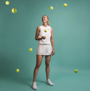 Tennis player Petra Kvitová against a turquoise background, looking up at tennis balls in the air around her. June 2019