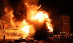 People attend a bonfire in the Sandy Row area of Belfast.