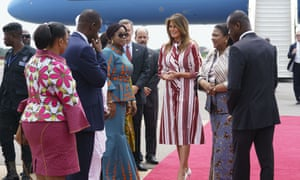 Melania Trump walks with Ghana's first lady, Rebecca Akufo-Addo,and Samuel Kumah, chief of protocol, during an arrival ceremony at Kotoka international airport in Accra, Ghana, on 2 October.