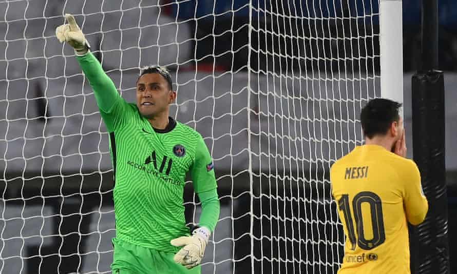 Keylor Navas celebrates after saving Lionel Messi's penalty.