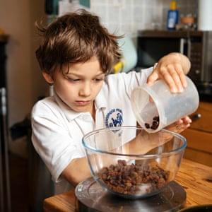 Nine-year-old Gabriel making malt loaf