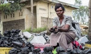 Women sells charcoal in Kenya