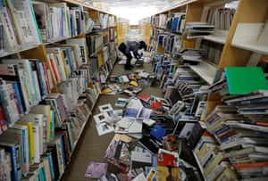 Iwaki City, JapanA staff member of library tries to restore books after they fell from book shelves by a strong earthquake in Fukushima prefecture