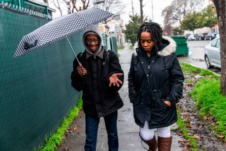 Carroll Fife, right, talks with Ms Gwen, an insecurely housed resident of Oakland, in January.