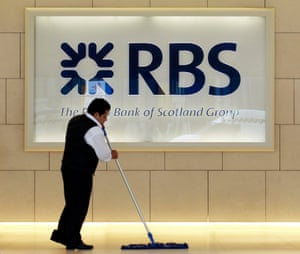 A worker sweeps in the foyer of a Royal Bank of Scotland office in the City of London.
