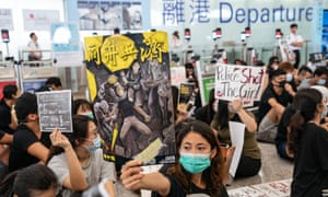 protesters in the departure hall of Hong Kong international airport on 13 August