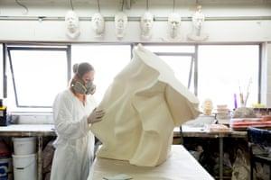 Moulder Nolwenn Caro makes a piece of sculpture inside the Artem studio