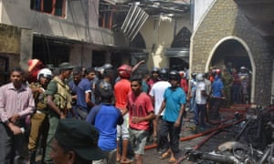 Locals and police gather at the Secon church, Batticalova central road in Colombo.