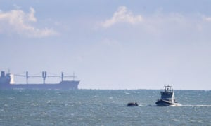 A Border Force vessel intercepting a group of people in a small boat thought to be migrants near Dover in Kent.