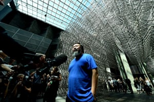 Ai Weiwei speaks to the Australian media in front of his work Forever Bicycles.