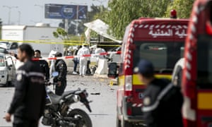 Forensic officers work on a blast site near the US embassy in Tunis.