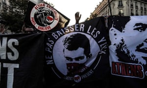 Demonstrators hold a banner carrying a picture of Clement Méric at a protest in Paris marking the end of the trial.