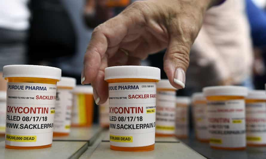 Family and friends who have lost loved ones to OxyContin and opioid overdoses leave pill bottles in protest outside the headquarters of Purdue Pharma, which is owned by the Sackler family, in Stamford, Connecticut.