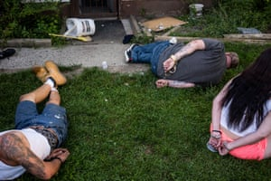 Suspects are handcuffed in the back yard after a police raid at a house in Flint.