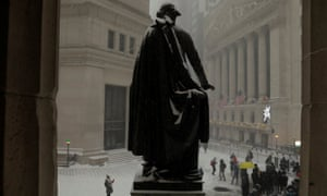 A snow-covered statue of former U.S. president George Washington on Wall Street today