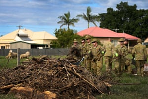 The Australian defence force emergency support team members help clear flood-damaged near Taree on 29 March.