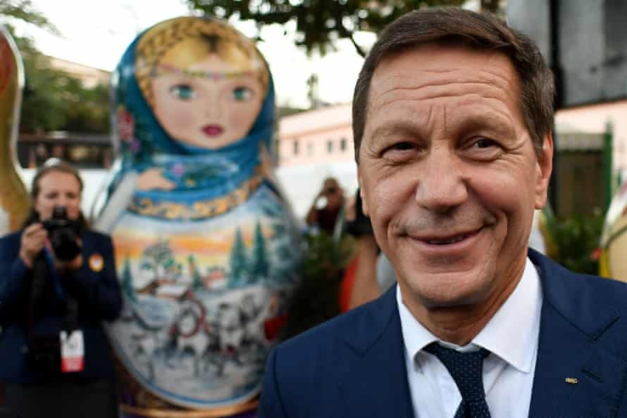 Russia's Olympic Committee (ROC) President Alexander Zhukov poses in front of a giant matryoshka doll as he attends the opening ceremony of the Russian fans' house at Copacabana beach in Rio de Janeiro on August 4, 2016, ahead of the Rio 2016 Olympic Games. / AFP PHOTO / Kirill KUDRYAVTSEVKIRILL KUDRYAVTSEV/AFP/Getty Images