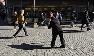 A man begging in Malmö, Sweden.