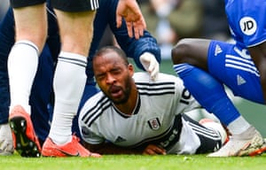 Fulham's Denis Odoi lays injured before being stretchered off after he was accidentally kicked in the head by his team-mate Maxime Le Marchand.