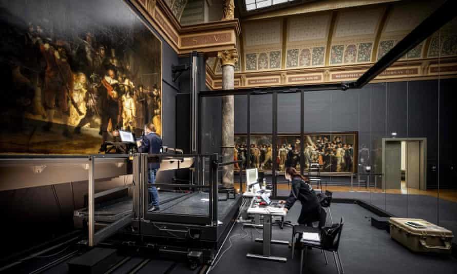 Restorers working on Rembrandt's Night Watch at the Rijksmuseum, Amsterdam.