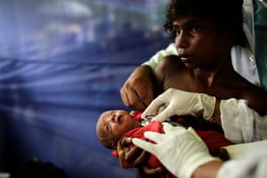 Cox's Bazar, BangladeshA doctor examines a 10-day-old Rohingya child in a medical centre. More than 500,000 Rohingya refugees have fled Myanmar recently