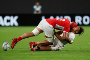 England's Anthony Watson drops the ball as he is tackled by Sione Kalamafoni of Tonga.