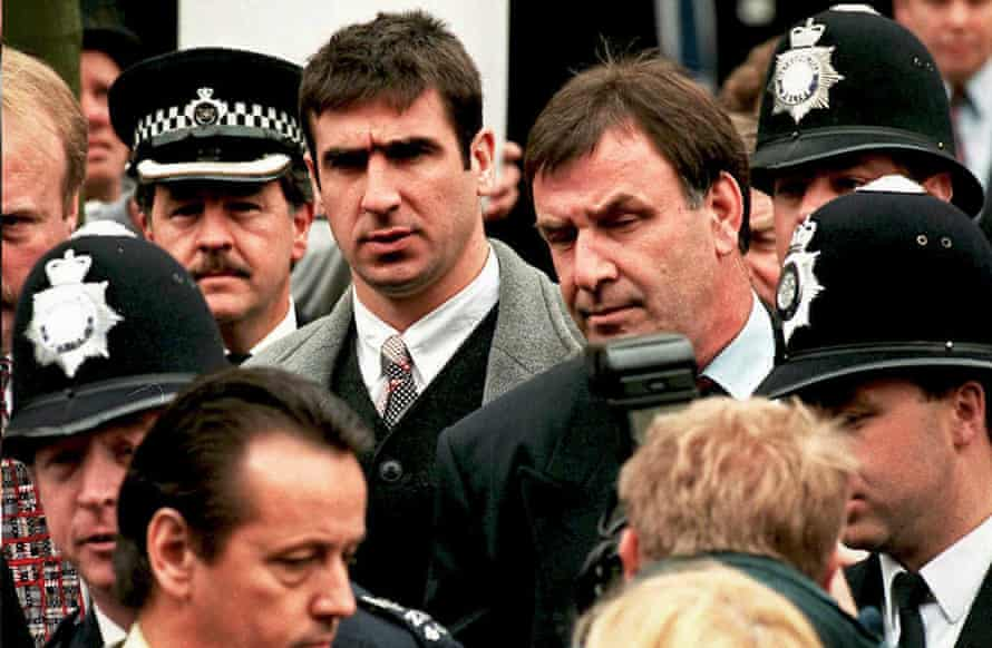 Eric Cantona leaves court after successfully appealing against a jail sentence for assaulting a Crystal Palace fan.