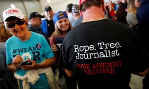 A Donald Trump supporter at a rally in Minneapolis, Minnesota, makes his feelings about journalists known.
