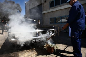 The smoking ceremony to purify the hearse