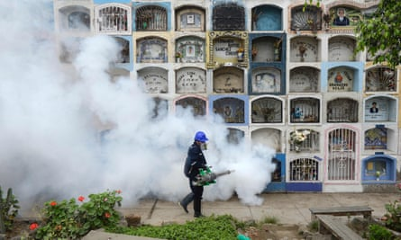 A fumigator at work in a graveyard in Lima as part of Peru's efforts to contain the Zika virus.