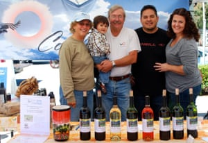 Steve Gliessman and his wife Robbie Jaffe, son Erin, his wife Oriana, and Mateo at the Westside farmers' market in Santa Cruz.