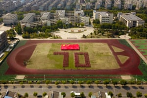 Students form a number 70 during an event to celebrate the anniversary in Yangzhou, Jiangsu province, on Saturday